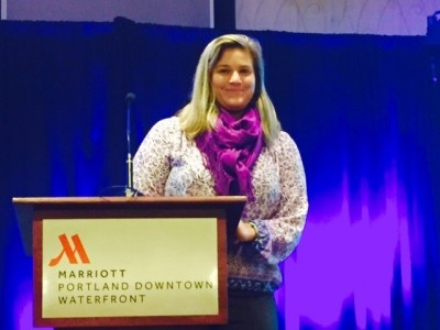 Former graduate student presenting at national conference